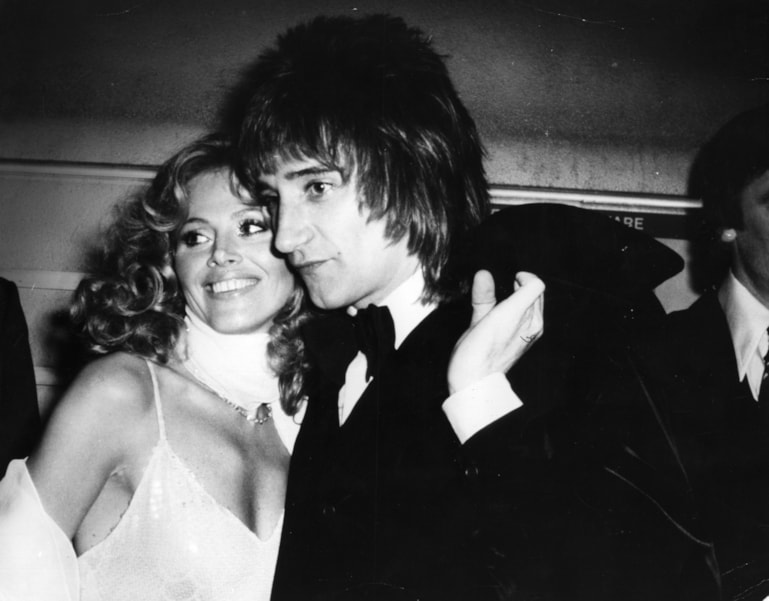 27th March 1975:  Pop singer Rod Stewart with his new girlfriend, actress Britt Ekland at the premiere of Ken Russell's new film of Pete Townshend's rock opera 'Tommy'. After kissing Britt, who recently split up with record producer Lou Adler and is the former wife of Peter Sellers, Rod said, 'It's the real thing'.  (Photo by Keystone/Getty Images)